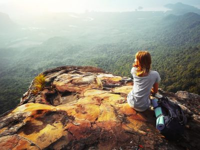 woman on mountain top - faith overcome fear