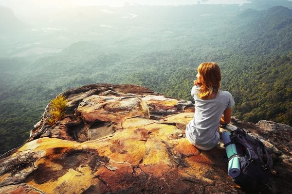 woman on mountain top - faith overcome fear